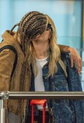 Ashley Benson & Cara Delevingne - Sharing a kiss at Heathrow Airport 8/13/18