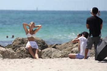 Caroline Kelley in a bikini during a photoshoot on the beach in Miami 8/22/18